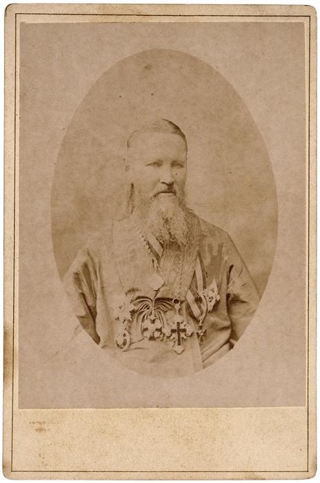 Кабинетная фотография Иоанна Кронштадтского. Кронштадт, [1890-е гг.].