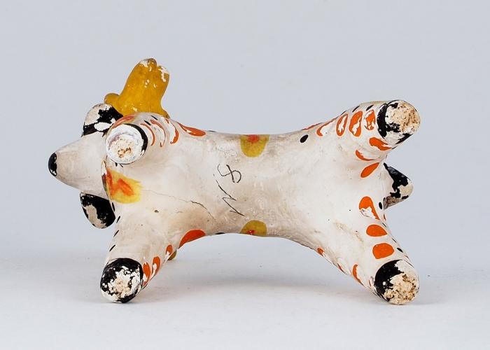 Игрушка глиняная «Олень». СССР, Дымково. 1930-е. Глина, лепка, роспись. Высота 10см.